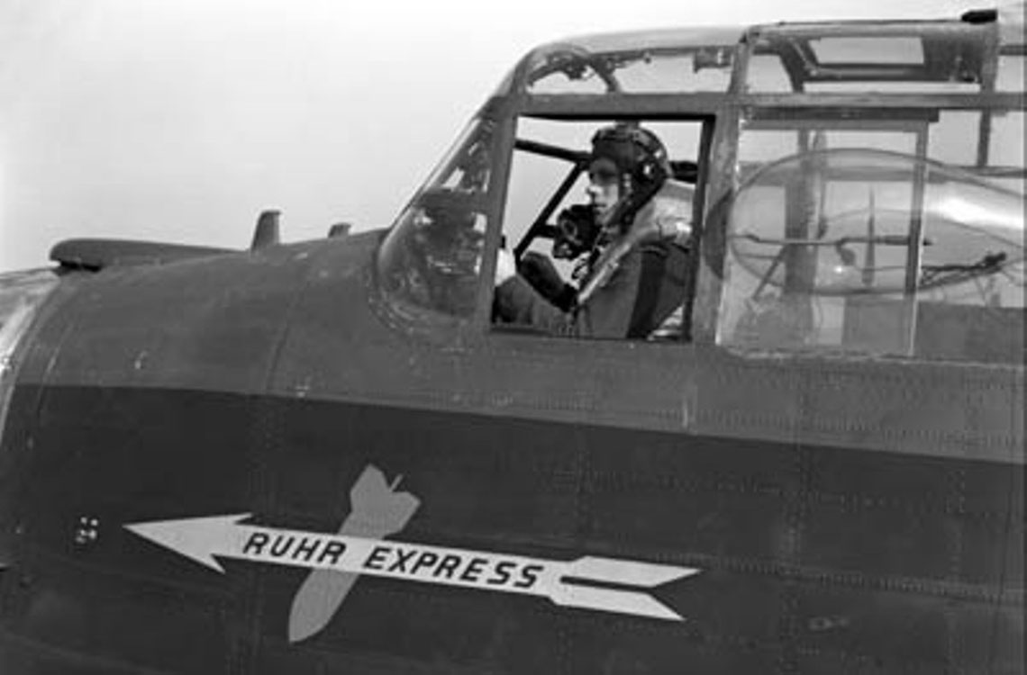 Pilot Officer Harold Floren sitting at the controls of KB700 Ruhr Express